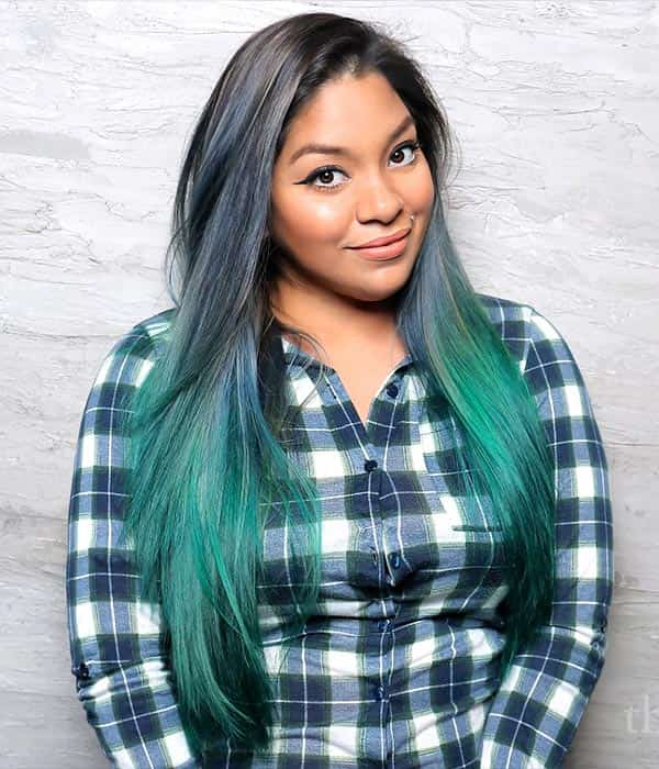 Smiling girl with green ombre hair.